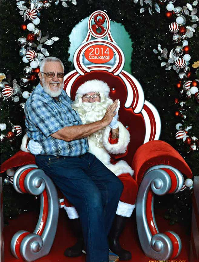 Ron Watkins sitting on Santa Claus' lap