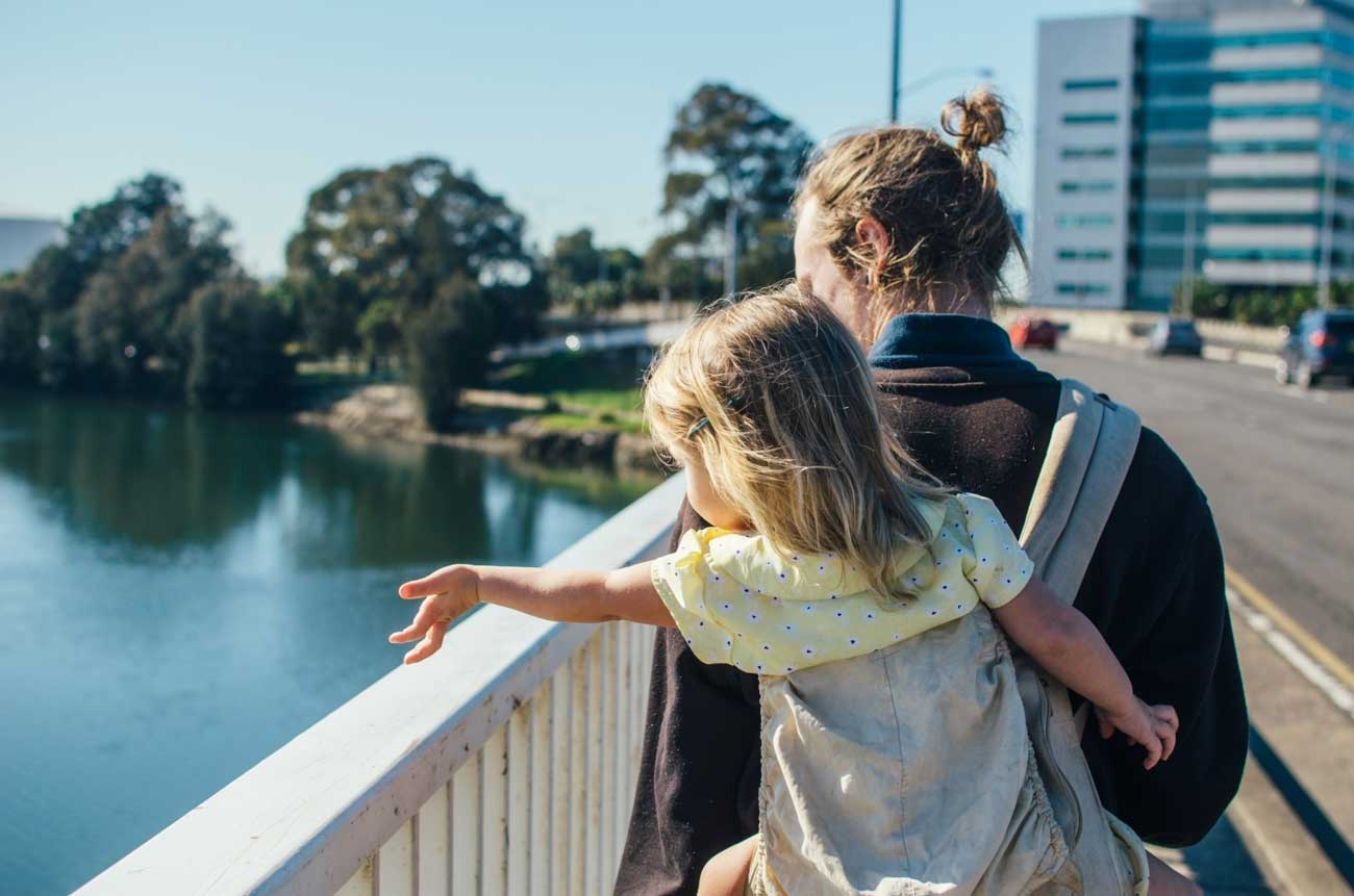 Father and daughter in the city overlooking the river