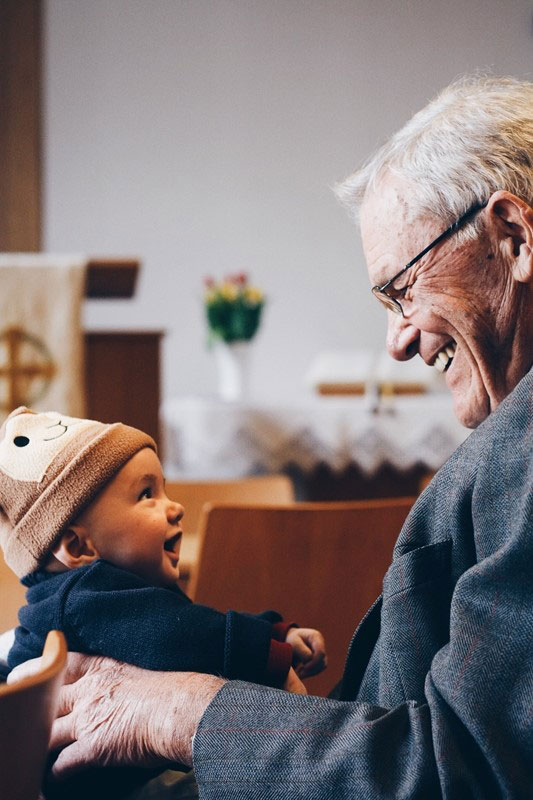 Grandfather playing with his grandchild