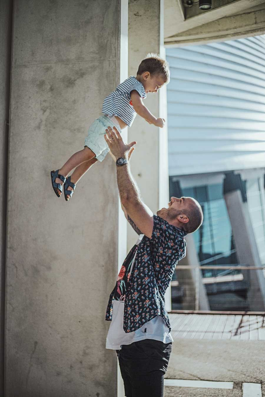 son trusting his dad to throw him up into the air