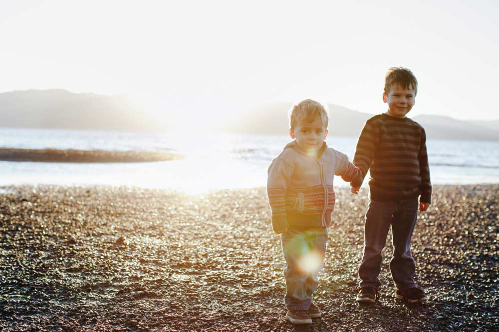 two boys holding hands