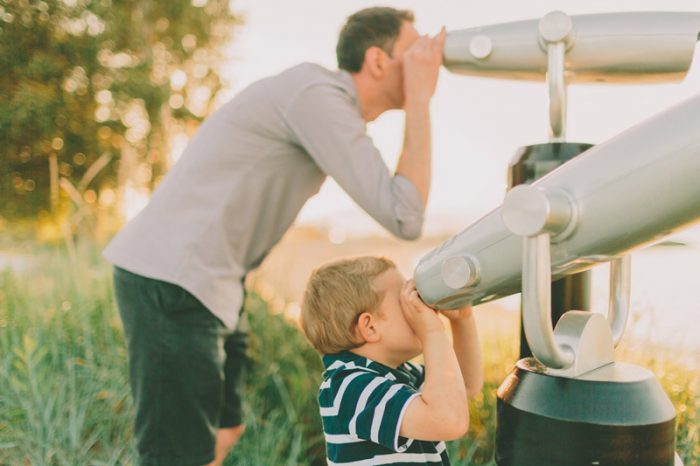 father and son on telescopes