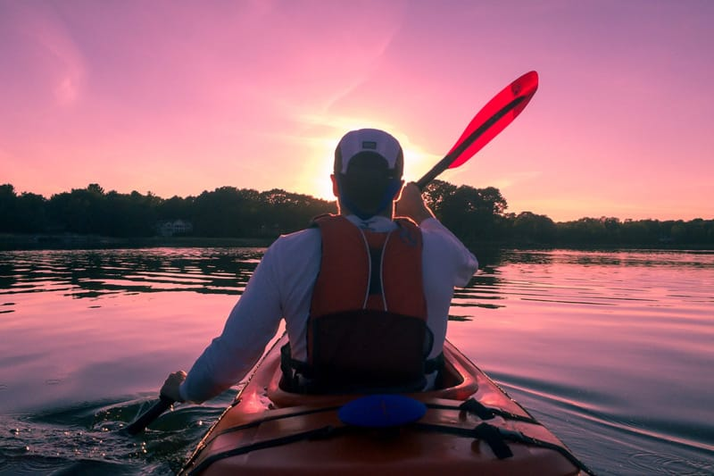 Kayaking man in the river