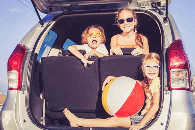Summer Savings - kids in the car ready for the beach